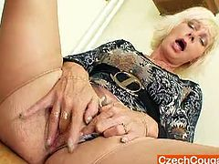 Naughty cougar slut rubs her clit sitting on the chair. Kinky teacher is eager for sex pleasure and tries to satisfy her lust in solo right in the staffroom.