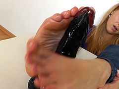 This dirty slut can't function unless she has something between her toes. She wraps her soles around a dildo and rubs her oily feet all over it. Just think how it would feel if she was pleasuring your cock with her toes.