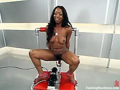 Sweet ebony girl Stacey Cash is having some fun alone. She gets her poontang pounded by a fucking machine and can't help but moan loudly with pleasure.