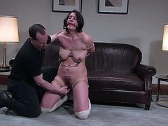 Brunette milf Karin Sin shows how slutty she really is. She lets some man tie her up and likes it much when he rubs her pussy with a dildo.