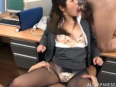Minami Asano gets a bukkake after working on a few cocks in an office