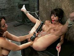 Sexy Gia Dimarco gets tied up and gagged. After that she gets her pussy fucked with the strap-on by Isis Love. Then she also gets fisted.