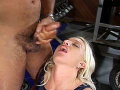 Fabulous blonde cheerleader Barbie Blazer is getting naughty with some black stud in a gym. She favours the guy with a blowjob and then leans forward letting him smash her coochie from behind.