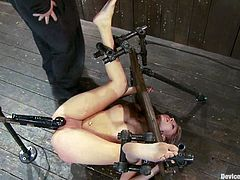This gorgeous and sizzling babe is experiencing a salvation! She gets submitted and the bondage device makes her feel helpless, when her master plays with her ass and pussy!