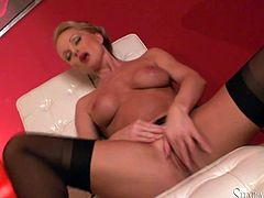 Check out this sexy blonde babe who is wearing high heels and sexy lingerie as she starts to strip naked, bend over and rub her wet pussy.