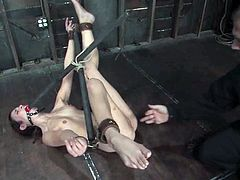 So two huge dildos, attached to the machine are pumping her asshole and her divine twat, while the vibrator makes her feeling something on her cleat.