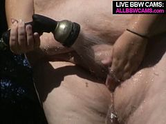 Kinky brunette BBW hoe waters plants on a loan. She then gets her T-shirt wet so the underwear sticks to her body. She gets rid of her clothes starting masturbating outdoor.