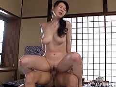 Pretty Japanese girl Hitomi Oohashi is having fun with her man in the bedroom. They have passionate oral sex and then fuck doggy style and in cowgirl position.