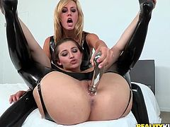 Brett Rossi and Dani Daniels pose in leather stockings and bodysuits. These chicks lick each others pussies and asses. In addition they use different sex toys to make it better.