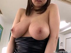 Big-breasted Japanese teacher Sayuki Kanno is having fun in a classroom. She shows her big natural tits to her students and then allows one of the dudes to play with her cunt.
