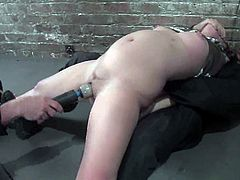 Cute brown-haired girl Devaun lets some man restrain and suspend her in a basement. The guy also rubs Devaun's vag and makes her get a wild orgasm.