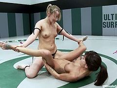 Two slim girls wrestle but they are not really good in this. After a fight they show what they can do better. Gia spreads her sexy legs and gets her vagina stuffed with a strap-on by hot Jessie.