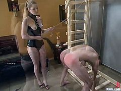 Billy Budd is getting naughty with sexy dominant blonde Princess Kali. Kali binds the guy and attaches leads to his balls and then pounds his tight butt with a strapon.