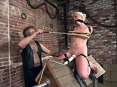 Naughty blonde girl hangs upside down for a while. Then she gets her tits tortured by her unmerciful master. Then she also gets toyed with a vibrator.