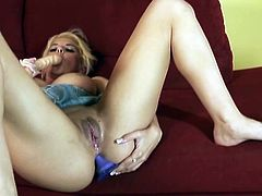 Kodi Gamble, a blond nymph that has some passion right now! She spreads her legs wide and starts rubbing her wet beaver with that device.