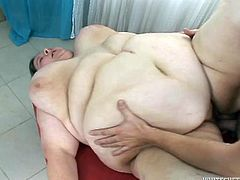 Very fat woman gives a blowjob to a guy in cook uniform. Then she takes her dress off and gets fucked rough by Marcel Manigati.