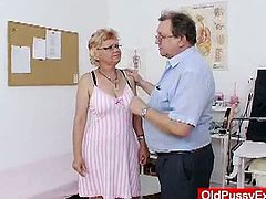 Check out horny grandma getting her pussy examined by her gynecologist. He opens her legs super wide and uses various toys for her dirty kinky cunt in his office.