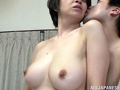 Meet Chiaki, a mature pussy that's in a great shape. This slut is not only fit and sexy, she's fucking horny too so the young guy will have a lot to work at. He plays with her panties, squeezing her pussy with them and then takes those panties off, getting more serious. The guy fingers and fucks her.