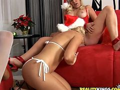Get a load of this hot lesbian scene orgy scene where these ladies please one another while they all wear Santa hats.