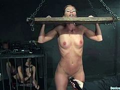Annie Cruz, Isis Love and Ariel X are having fun in a basement. Isis puts the other two girls into irons, tortures them and then smashes their snatches with a dildo.