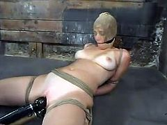 Slim girl gets tied up and gagged. Then this chick gets her tits tortured and pussy drilled with big dildos.
