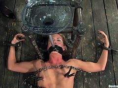 Tied on the floor with chains, this bitch is about to receive a humiliating treatment. A funnel is inserted in her mouth and she receives a drink from the brunette slut. There's some kinky shit going on here, so don't miss it. This worthless cunt deserves humiliating and painful treatment!