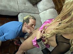 Watch this guy sucking this blonde shemale's big cock before she drills his tight asshole with it on camera.