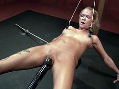 Lovely blonde girl gets undressed and tied up by her master. Later on he fixes claws to her pussy lips and gapes the pussy. Later on he also drills her vagina with massive dildo.