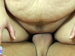 This fat woman can hypnotize any man with her big natural tits. This spoiled brunette has a huge sexual appetite. She sucks her lover's cock greedily paying special attention to his balls. Then he fucks her thick muff in doggy position.