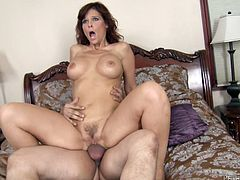 Get a load of this hardcore video where a horny milf sucks on this stud's big cock before he pounds her wet pussy.