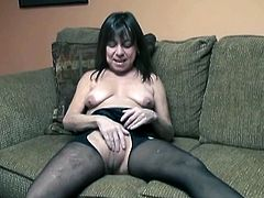 Voracious mommy looks ugly. Nasty bitch displays her saggy udders and drills her disgusting cunt with big didlo in doggy pose.