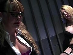 Two lustful trannies have wild anal sex in a prison