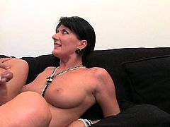 Sizzling brunette milf is getting naughty with some dude indoors. She sucks and rubs his wang ardently and then enjoys some naughty doggy style banging.