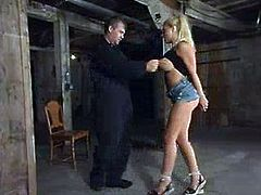 Luscious blond babe Candy Manson is under some severe action. Babe gets her hands suspended up and then her tits get purple.