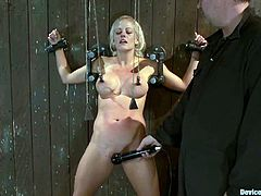 Hot blonde girl gets chained to a wall. Then a guy fixes claws to her nipples and also tortures her vagina.