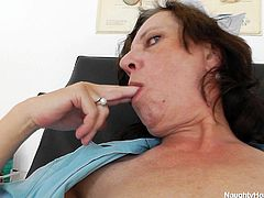 Nurse Slavena had a hard day of work and now it's time for relaxation. What other better way to relax then have some fun with herself! Slavena spreads her thighs right there in her medical office and begins gaping her hairy pussy. She shows us her cunt and then sucks her fingers. Will she finger herself for us?