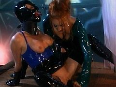 Alluring babes in latex costumes are having an amazing time during femdom BDSM show