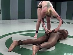 Kinky Darling gets a win over ebony Safari with by some miracle. So, she enjoys her glorious victory. Darling toys Safari's pussy with a vibrator and a strap-on.
