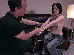 Kinky brunette girl undresses and then gets tied up at the casting. Later on she gets her vagina toyed and tits pinched.