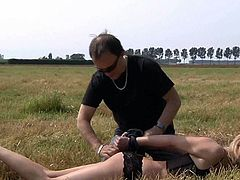 Cocky master walks with his blonde slave girl i the open field. Submissive blonde babe gets her juicy ass spanked hard before taking that dick up her soaking cunt on her side from behind.