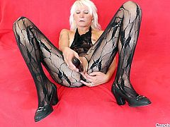 She likes it black! Black nylons, black dildo and what else does Bernadeta likes it black? Well now, it seems that all she was is a dildo but that won't keep her away from having a good time. Stay with this blonde cougar and find out if she will receive the real black thing after she fucks herself.