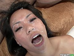 Petite Asian bitch with tight ass and small titties gets her coochie pounded by big black dick doggystyle. After fucking in sideways position Asian slut gets her face covered with black jizz.