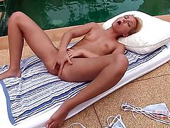 Blonde oriental Nataly Von strips and plays with herself for your viewing enjoyment