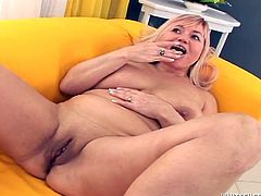 Chubby blonde mom with saggy boobs is plays with her pussy in front of horny black stud. She then gives deepthroat blowjob to him. She later takes hard dong in her slick wet pussy.