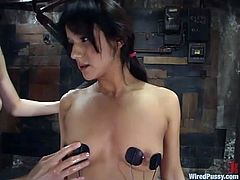 Brunette hottie Nadia Styles is having fun with some chick in a basement. Nadia lets the mistress bind her and then moans with pleasure when the dominatrix fingers and toys her shaved pussy.