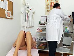 Redhead granny Milada is at her doc for an examination. The old doc measures her and then he asks her to spread those sexy thighs for a pussy exam. He gapes her tight, pink pussy and shows it to us. It seems that her vagina is in perfect condition and that it needs some stretching!