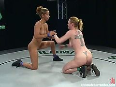 Harmony tries to win a superior opponent but she fails. Isis Love stuffs Harmony's mouth and pussy with a strap-on right after a fight.