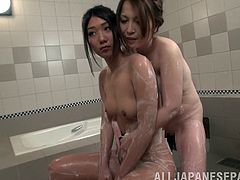 Pretty Japanese girl Sawa Matsuoka and her awesome GF are having fun in a bathroom. The cuties soap and rub each other's bodies and then suck some man's dick and ride it by turns.