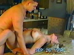 Press play and watch this guy being surprised by his horny blonde wife as she sucks on his big prick before letting him fuck her all over the kitchen.