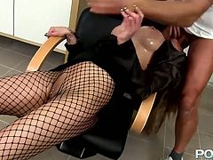 He grabs her by her head and pulls her towards his rock hard erection so she can blow him. She sucks his stiff dick with unrestrained passion. Then he bangs her from behind.